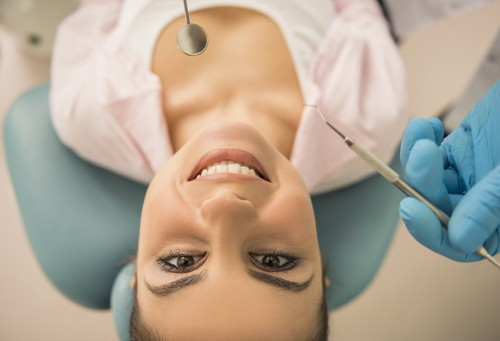young lady in dental chair looking up