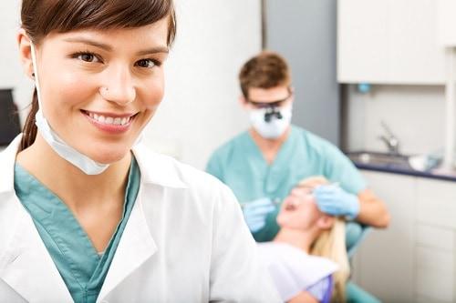 female hygienist in foreground