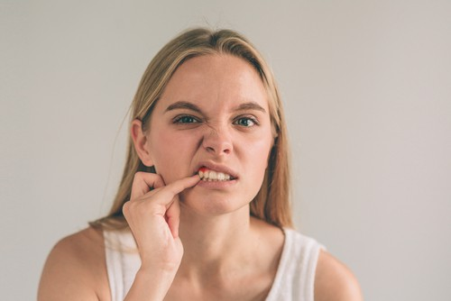 woman with gum pain